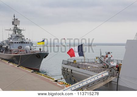 Odesa, UKRAINE - MARCH, 26, 2015: Ukrainian and French warships standing in the sea port of Odesa