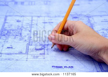 Contractor Marking Blueprints