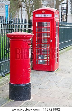 Famous red post box and telephone booth in London, UK