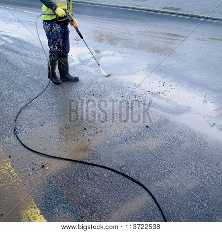 Cleaning street with hose