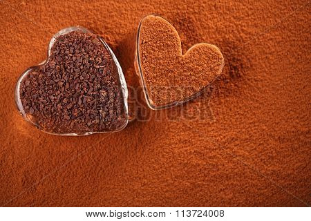 cocoa powder and grated dark chocolate with  heart shaped glass, perfect color and background