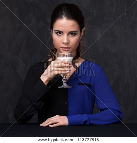 Portrait Or An Attractive Brunette With A Glass Of Milk