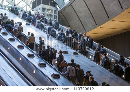 Lots of people going up to escalator in Canary Wharf,  London