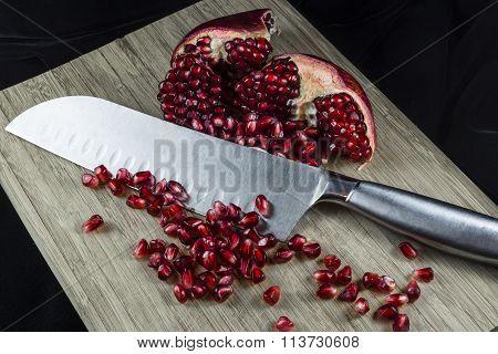 Pomegranate On Cutting Board