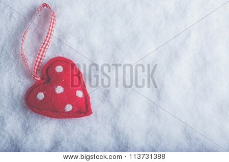 Red Toy Suave Heart On A Frosty White Snow Background. Love And