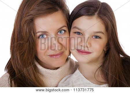 Close up portrait of a beautiful ten year old little girl and happy mother, isolated on white background