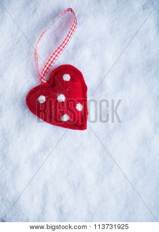 Red Toy Suave Heart On A Frosty White Snow Winter Background. Lo