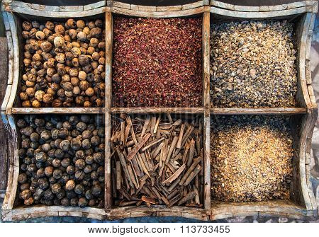 Assortment of spices in wooden box.