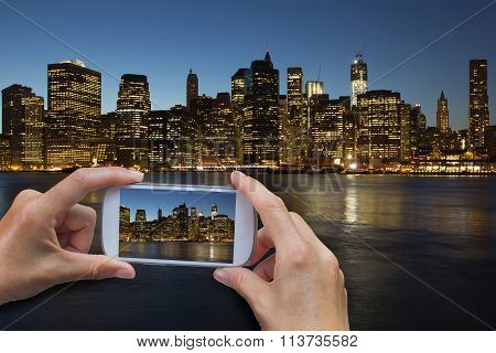 Taking A Picture Of Lower Manhattan At Night
