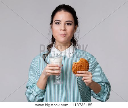 Young Brunette  Chewing A Cookie