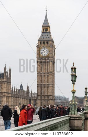 Big Ben London And People Walking On The Westminster Bridge