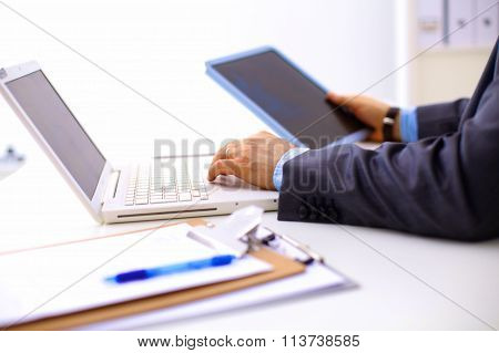 businessman working at a computer hands closeup