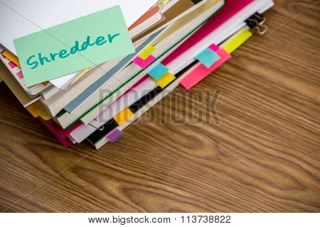 Shredder; The Pile Of Business Documents On The Desk