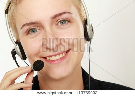 Female call center operator with headphone browsing on her computer