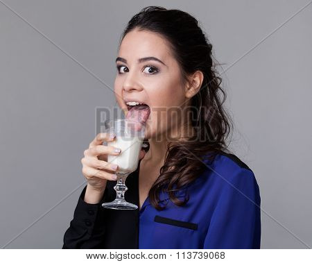 Young Brunette Licking Milk From A Goblet