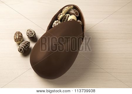 Chocolate Easter Eggs Over Wooden Background.