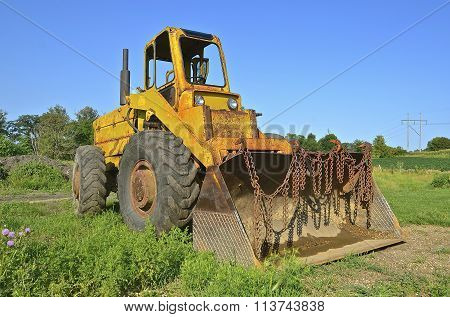 Old earth mover with bucket