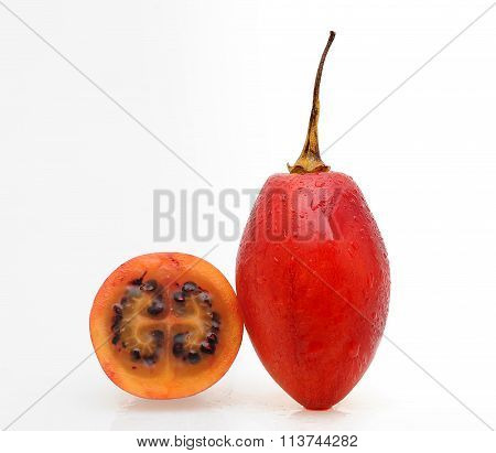 Tamarillo fruits with slice on white background