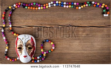Venetian carnival mask on a wooden background