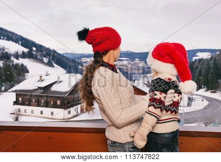 Seen From Behind Mother And Child Looking Snow-capped Mountains