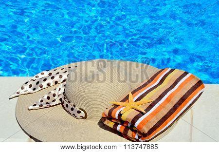 Woman Beach Hat, Bright Towel And Starfish