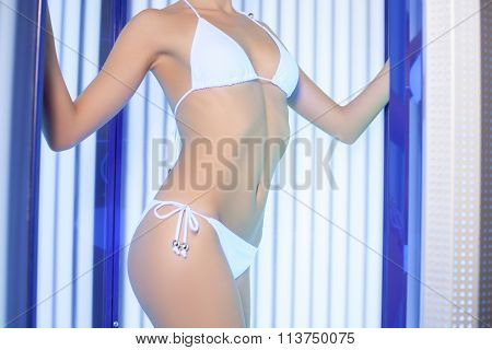 Attractive healthy girl is acquiring a tan