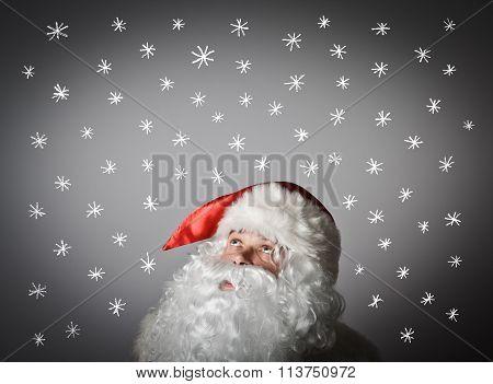 Santa Claus And And Snowflakes