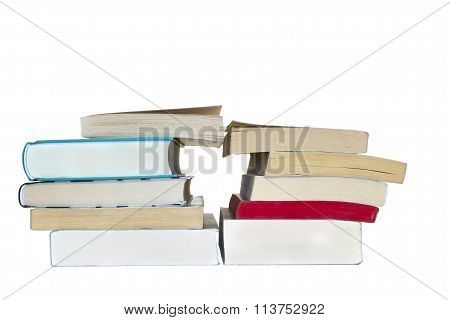 Two piles of books with a triangle in the middle, isolated over white background