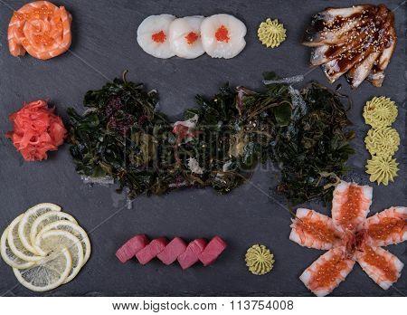 Sashimi set, sushi on a black background, Japanese cuisine