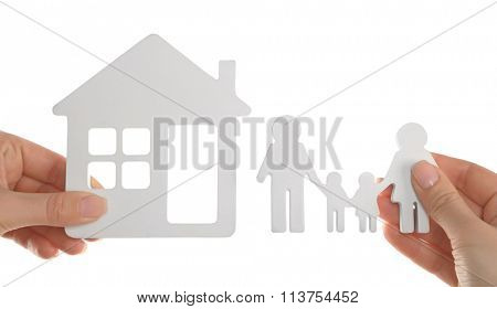 Female hands holding models of house and family isolated on white