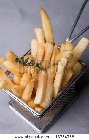 Fried potatoes fries, served in an iron bowl