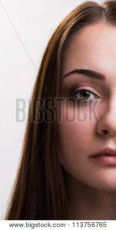 Emotion series of young and beautiful ukrainian girl - serious. half face photo