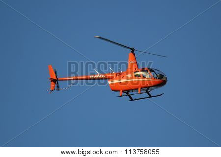 The Robinson R44 Helicopter from Cana Fly flying with tourists in Punta Cana.