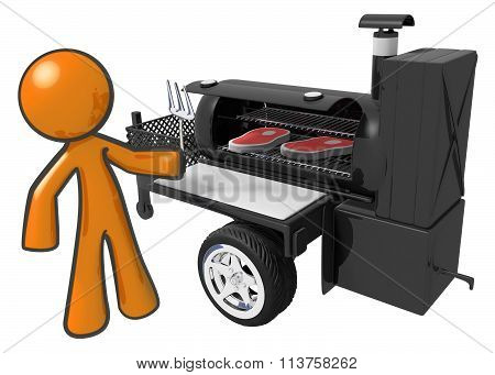 Man Cooking Steaks On Mobile Grill