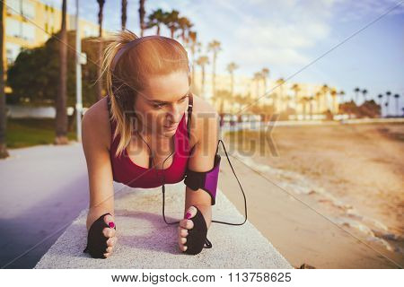 Young Blonde Woman Exercising On Beach