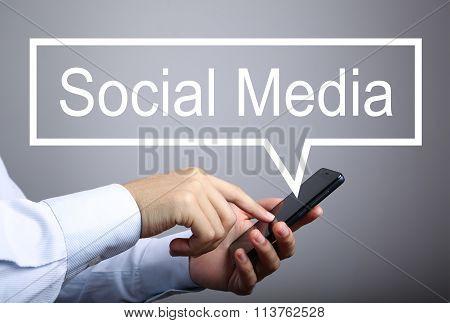 Businessman Use Smart Phone With Social Media Speech Bubble