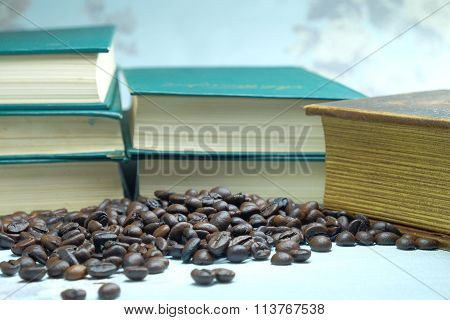 coffee beans in the background of a closed book