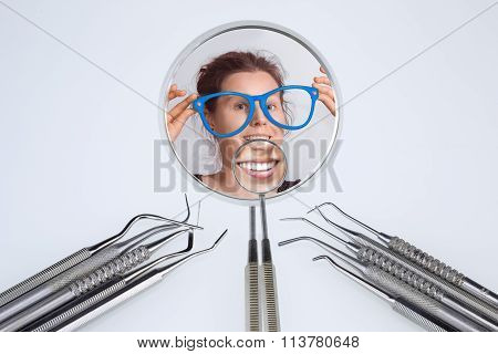 Dentist's Tools And Two Dentist's Mirrors With Woman's Smile