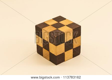 Wooden snake cube puzzle