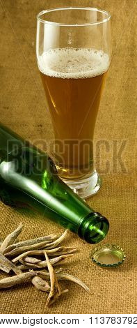 Bottle, A Glass Of Beer And Dry Fish Closeup
