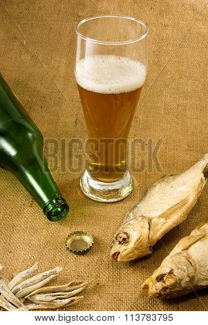 Bottle, A Glass Of Beer And Dry Fish