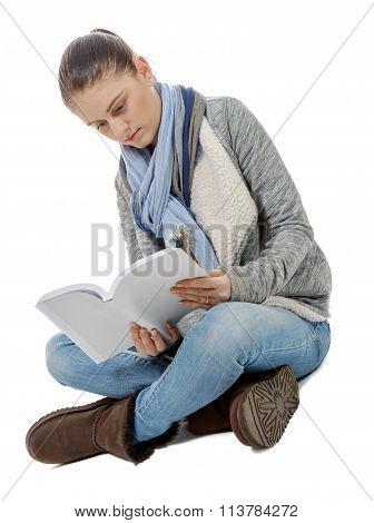 Beautiful Girl Sitting Cross-legged, Reading A Book On A White Background