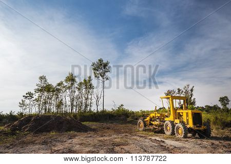 Wheel Loader Excavator In The Field With Clear Bule Sky