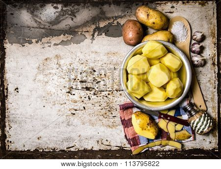 The Concept Of Peeled Potatoes In A Bowl On The Rustic Background . Free Space For Text.