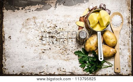 The Concept Of A Peeled Potato In The Pot On The Rustic Background . Free Space For Text.