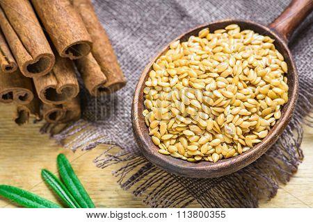 Golden linseed in wooden spoon