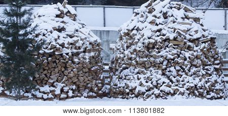 Firewood stacked in winter.