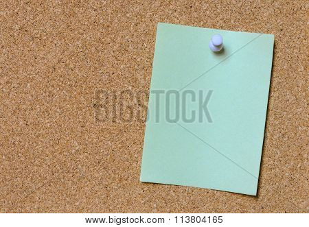 Blank Green Note Pinned On Cork Board