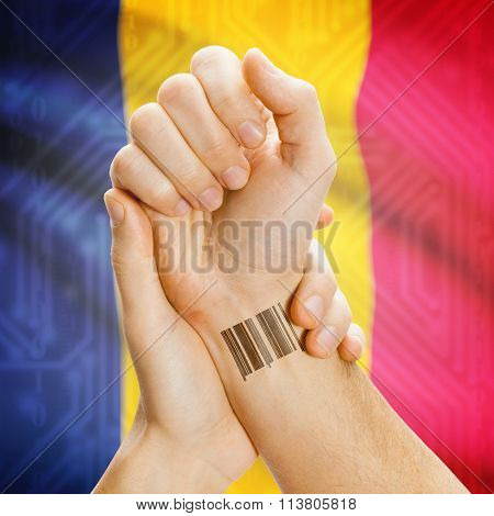 Barcode Id Number On Wrist And National Flag On Background - Chad
