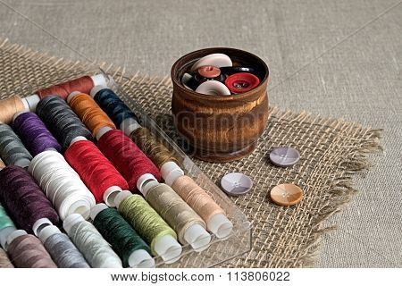 Buttons for clothes and sewing thread spool.